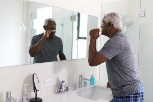 man brushing his teeth in the morning